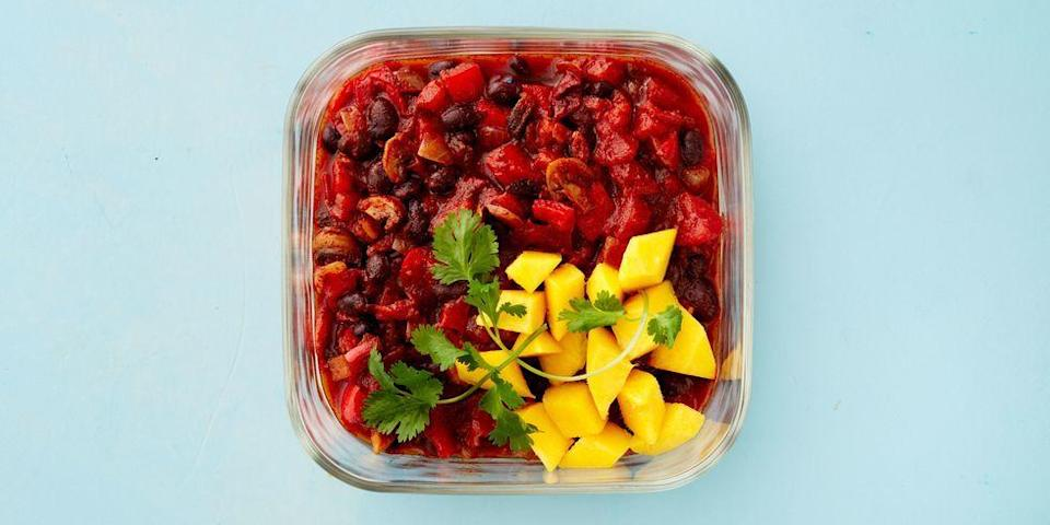 """<p>Top this smoky bean chili with sweet sliced mango and <a href=""""https://www.goodhousekeeping.com/food-recipes/g2767/pumpkin-seed-recipes/"""" rel=""""nofollow noopener"""" target=""""_blank"""" data-ylk=""""slk:crunchy pumpkin seeds"""" class=""""link rapid-noclick-resp"""">crunchy pumpkin seeds</a> for an extra boost of Vitamin C and Magnesium.<br></p><p><em><a href=""""https://www.goodhousekeeping.com/food-recipes/healthy/a47237/healthy-bean-chili-recipe/"""" rel=""""nofollow noopener"""" target=""""_blank"""" data-ylk=""""slk:Get the recipe for Healthy Bean Chili »"""" class=""""link rapid-noclick-resp"""">Get the recipe for Healthy Bean Chili »</a></em></p>"""