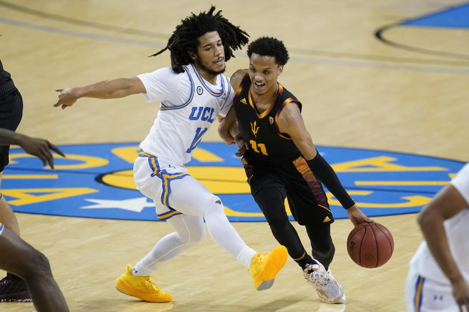 UCLA guard Tyger Campbell (10) defends against Arizona State guard Alonzo Verge Jr. (11) during the first half of an NCAA college basketball game Saturday, Feb. 20, 2021, in Los Angeles. (AP Photo/Ashley Landis)