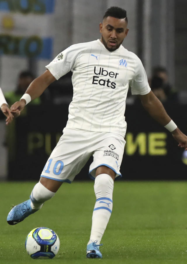 FILE - In this file photo dated Friday, Nov. 29, 2019, Marseille's Dimitri Payet in action during the French League One soccer match against Brest at the Velodrome stadium in Marseille, southern France. Marseille's club president Jacques-Henri Eyraud on Sunday June 28, 2020, praised playmaker Dimitri Payet for accepting a significant pay cut when signing a new two-year deal until 2024. (AP Photo/Daniel Cole, FILE)