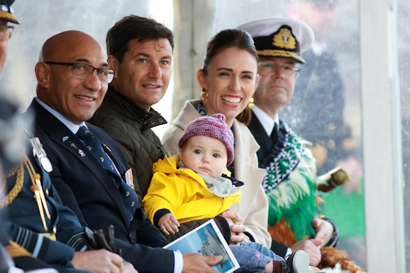 AUCKLAND, NEW ZEALAND - JUNE 07: Prime Minister Jacinda Ardern,her partner Clarke Gayford, and their child Neve look on after the Prime Minister formally commissioned the diving support and hydrographic survey vessel Manawanui into the Royal New Zealand Navy (RNZN) on June 07, 2019 in Auckland, New Zealand. It is the first time in nine years an RNZN ship has been commissioned. (Photo by Phil Walter/Getty Images)