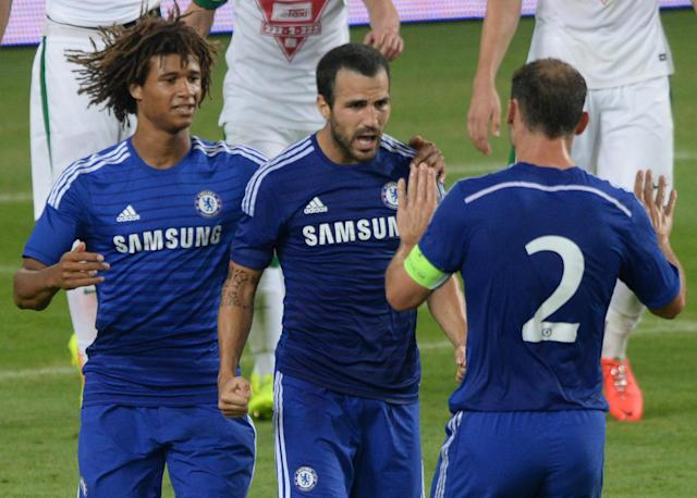 Chelsea's Cesc Fabregas (C) congratulated by teammates after scoring a goal at the Groupama Arena new football stadium in Budapest on August 10, 2014 (AFP Photo/Attila Kisbenedek)