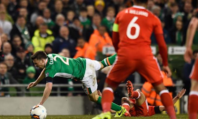 "<span class=""element-image__caption"">Séamus Coleman is sent flying by Wales's Neil Taylor, a tackle which broke the right leg of the Republic of Ireland defender and saw Taylor sent off.</span> <span class=""element-image__credit"">Photograph: Clodagh Kilcoyne/Reuters</span>"