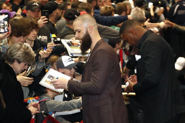 Chicago White Sox's Dallas Keuchel, center, gives autographs after he was introduced during the team's annual fan convention Friday, Jan. 24, 2020, in Chicago. (AP Photo/Charles Rex Arbogast)