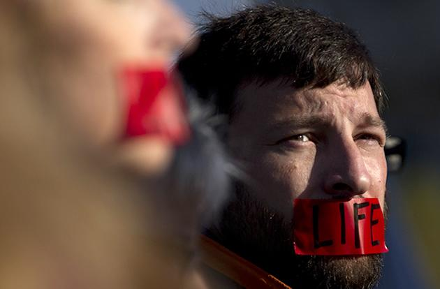 """A member of """"Bound 4 Life"""" protests outside the Supreme Court ."""