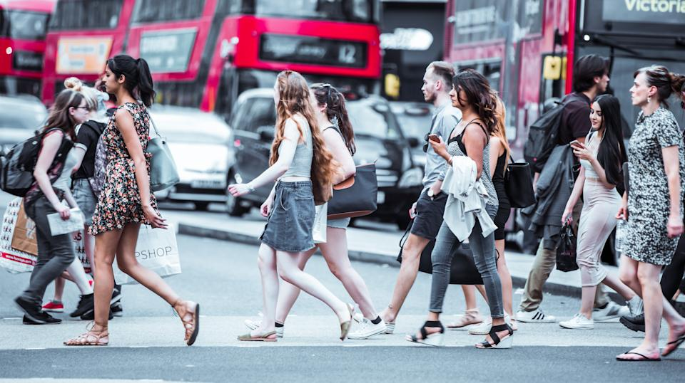 London, UK - 24 August, 2016: Lots of people walking in Oxford street, is the main destination of tourists and Londoners for shopping. People caring shopping bags. Modern life concept