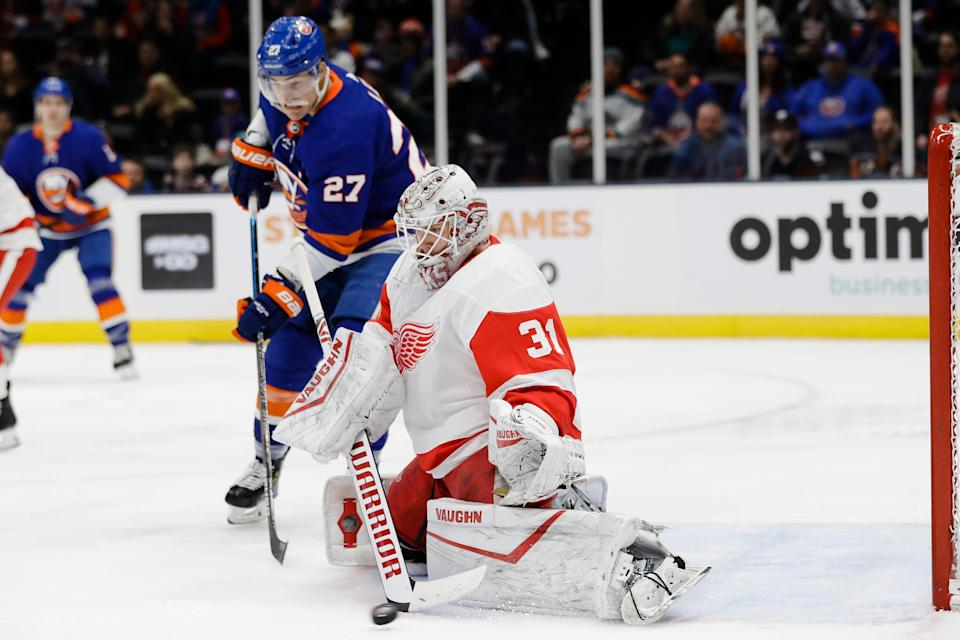 Detroit Red Wings goaltender Calvin Pickard (31) stops a shot on goal as New York Islanders' Anders Lee (27) watches during the second period of an NHL hockey game Tuesday, Jan. 14, 2020, in Uniondale, N.Y. (AP Photo/Frank Franklin II)