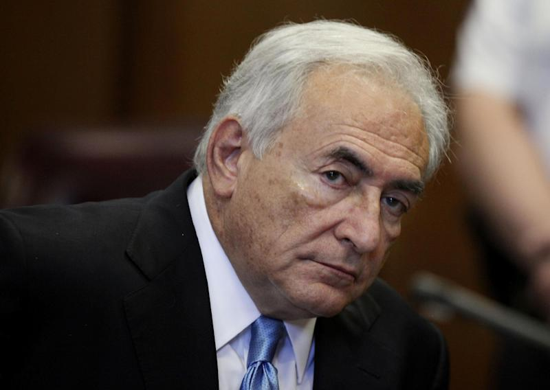 FILE - In this July 1, 2011 file photo, former International Monetary Fund leader Dominique Strauss-Kahn listens to proceedings in New York State Supreme court in New York. Former IMF chief Dominique Strauss-Kahn will have to defend himself in a French court on aggravated pimping charges. Judges investigating the case in the northern French city of Lille decided on Friday, July 26, 2013 to go ahead with charges of aggravated pimping in a group _ instead of heeding a demand from prosecutors office. Prosecutors said in June that there's not enough evidence to maintain the charges. (AP Photo/Todd Heisler, Pool, File)