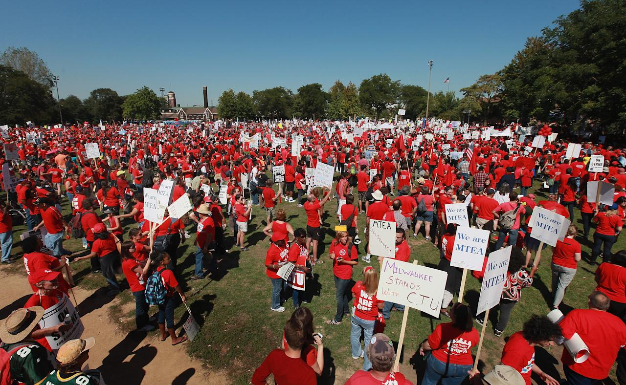 """Striking Chicago teachers and their supporters attend a rally at Union Park September 15, 2012 in Chicago, Illinois. An estimated 25,000 people gathered in the park in a show of solidarity as negotiations on a labor contract continue. Yesterday Chicago Teachers Union President Karen Lewis reported the """"framework"""" for an agreement has been reached and union delegates are expected to decide tomorrow if they should end the strike. More than 26,000 teachers and support staff walked off of their jobs on September 10 after the union failed to reach an agreement with the city on compensation, benefits and job security. With about 350,000 students, the Chicago school district is the third largest in the United States.  (Photo by Scott Olson/Getty Images)"""