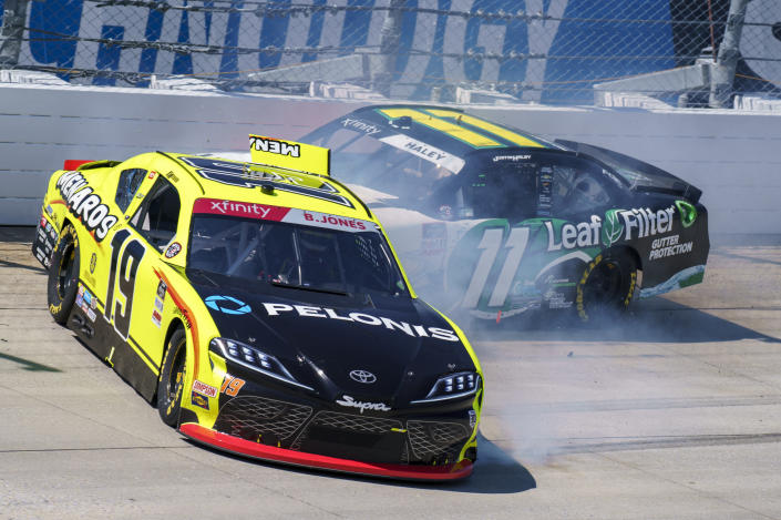 Brandon Jones, left, and Justin Haley, right collide coming out of turn 1 during a NASCAR Xfinity Series auto race at Dover International Speedway, Tuesday, June 15, 2021, in Dover, Del. (AP Photo/Chris Szagola)