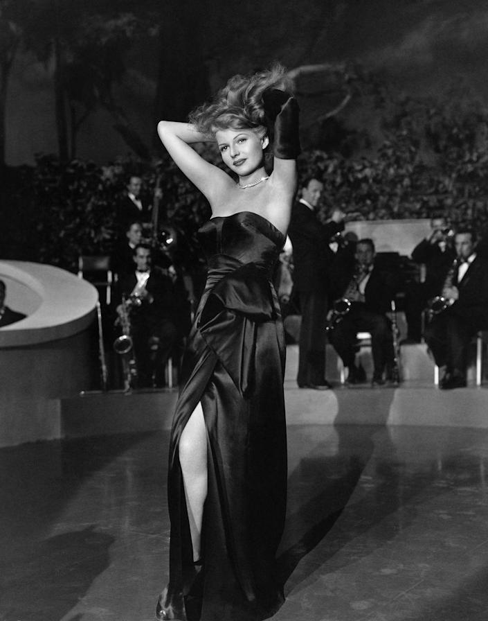 <p>Rita Hayworth's iconic <em>Gilda </em>outfit was made even more glamorous by her diamond tennis necklace. The thin choker was subtle but dazzling, and made a statement against her strapless satin evening gown. </p>