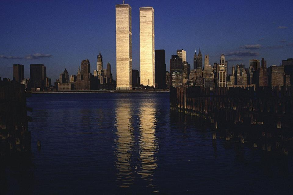 <p>The World Trade Center's reflection shines across the water at dusk on September 10, 1979.</p>