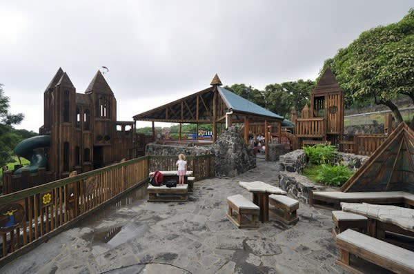 """<div class=""""caption-credit""""> Photo by: Flickr/Chimey Bleu</div><div class=""""caption-title"""">Kamakana Playground, Kona Hawaii</div>Located on the Big Island, this playground boasts a zip line, model train and ship, climbing structures, and incredible views. For those who prefer to exercise their brains, there are chess tables built into lava rock."""