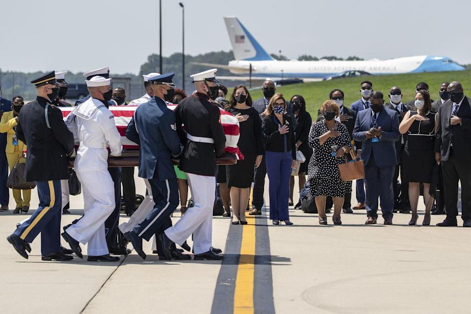 <p>Lewis's casket arrived at Andrews Air Force Base, in Maryland near Washington, D.C. The casket was draped with an American flag and carried by a joint services military honor guard. Representative Nancy Pelosi and Lewis's family members looked on.</p>