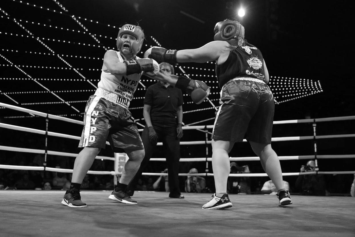Stacy Weinstein, left, and Katie Walsh battle it out in the ring during the NYPD Boxing Championships at the Theater at Madison Square Garden on June 8, 2017. (Gordon Donovan/Yahoo News)