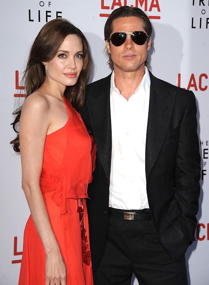 """<a href=""""http://movies.yahoo.com/movie/contributor/1800019275"""">Angelina Jolie</a> and <a href=""""http://movies.yahoo.com/movie/contributor/1800018965"""">Brad Pitt</a> attend the Los Angeles premiere of <a href=""""http://movies.yahoo.com/movie/1810022079/info"""">The Tree of Life</a> on May 24, 2011."""