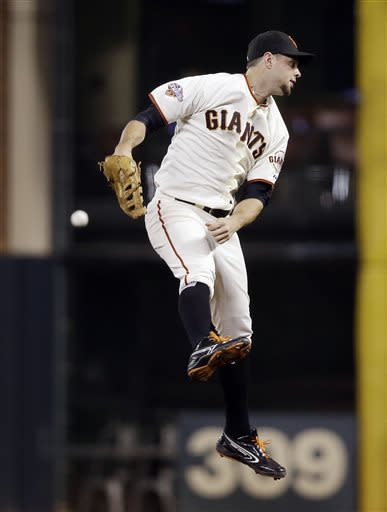 San Francisco Giants first baseman Brandon Belt leaps but can't catch a line drive from Cincinnati Reds' Xavier Paul during the seventh inning of a baseball game on Monday, July 22, 2013, in San Francisco. Paul got a double on the play. (AP Photo/Marcio Jose Sanchez)