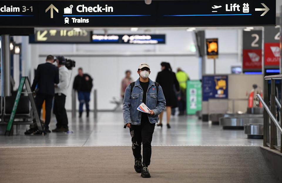 Passengers wearing face masks at Sydney Airport after arriving on a Jetstar flight. Source: Getty