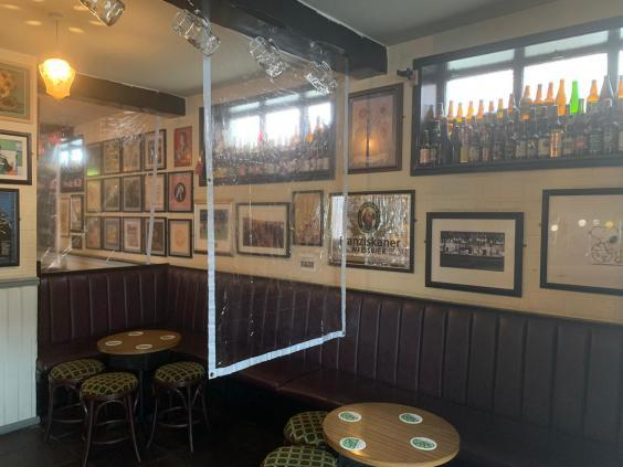 The Sunflower pub in Belfast is fitted out with plastic screens for social distancing (@AmandaFBelfast)