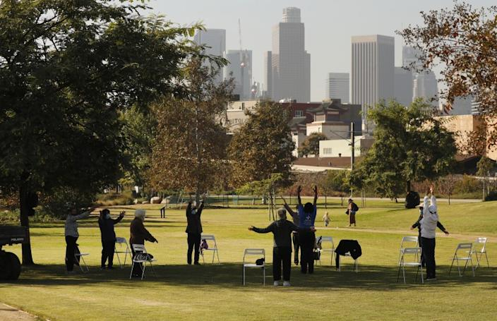 LOS ANGELES, CA - NOVEMBER 19: Sipoo Shelene Hearring leads seniors in a Yang Style Tai Chi class at Los Angeles State Historic Park on Thursday November 19, 2020. A company funded by former Dodgers owner Frank McCourt has proposed a $125 million gondola lift that would fly customers over Los Angeles State Historic Park from Union Station to Dodger Stadium and activists are weighing in. Parents with children and local residents savored the grand opening of the new park in 2017 sandwiched between Chinatown and the L.A. River. Los Angeles State Historic Park, about a 10-minute walk from City Hall, has blossomed into a popular 32-acre urban oasis. Los Angeles State Historic Park on Thursday, Nov. 19, 2020 in Los Angeles, CA. (Al Seib / Los Angeles Times