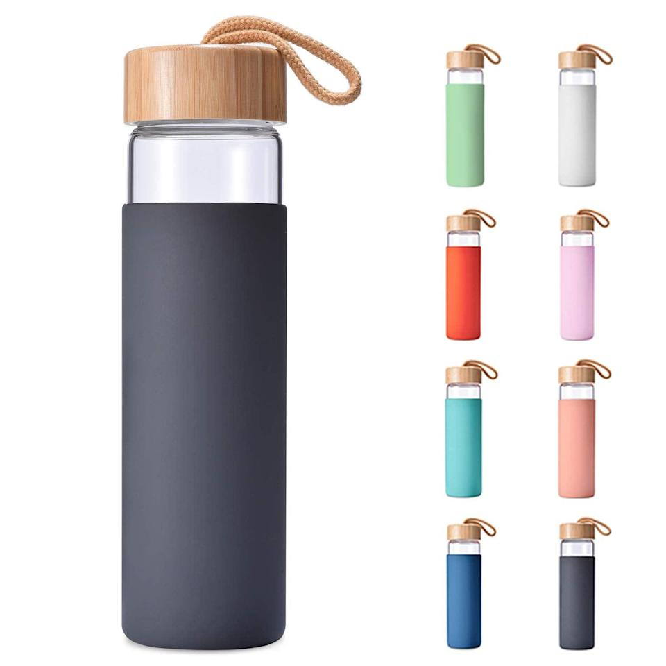 """<h3>Yomious 20 Oz Borosilicate Glass Water Bottle with Bamboo Lid and Silicone Sleeve</h3><br>This highly-rated, under-$20 Amazon gem comes in a rainbow of colors, and features a sustainable bamboo lid.<br><br><strong>Yomious</strong> 20 Oz Borosilicate Glass Water Bottle with Bamboo Lid a, $, available at <a href=""""https://amzn.to/2WvRfCQ"""" rel=""""nofollow noopener"""" target=""""_blank"""" data-ylk=""""slk:Amazon"""" class=""""link rapid-noclick-resp"""">Amazon</a>"""