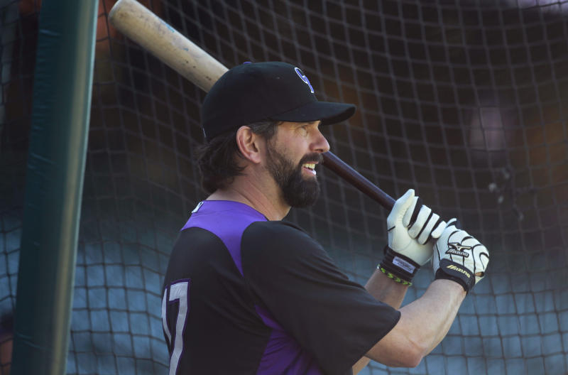 Colorado Rockies first baseman Todd Helton prepares to take batting practice before the Rockies faced the Boston Red Sox in a baseball game in Denver on Wednesday, Sept. 25, 2013. Helton, who will retire at season's end, is playing in his final home game on Wednesday. (AP Photo/David Zalubowski)