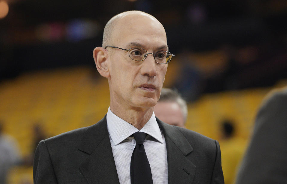 Adam Silver is confident that the NBA's Disney World bubble will shield participants from Florida's COVID-19 outbreak. (AP Photo/Tony Avelar)