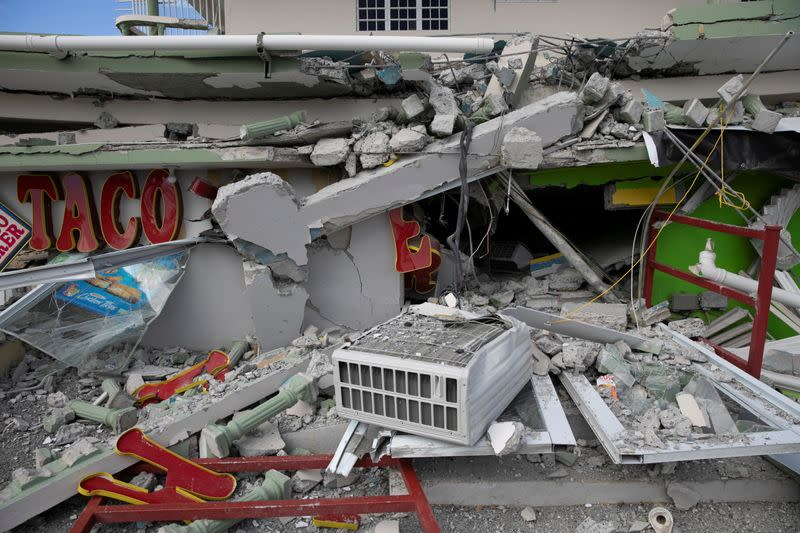 A collapsed shop is seen after an earthquake in Guanica
