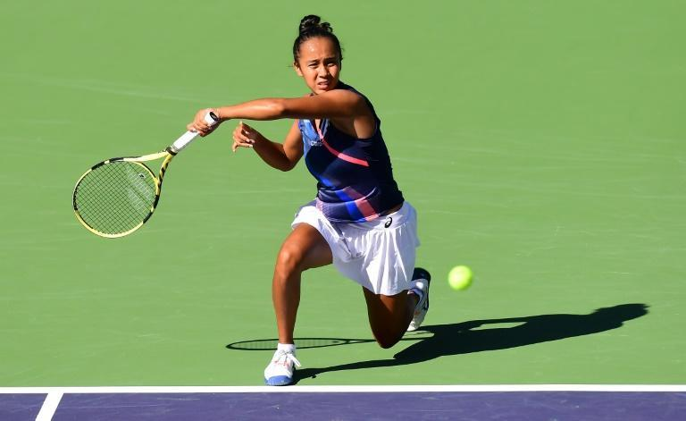 Leylah Fernandez held serve in a lengthy 12th game of the third set to set up the tiebreaker (AFP/Frederic J. BROWN)