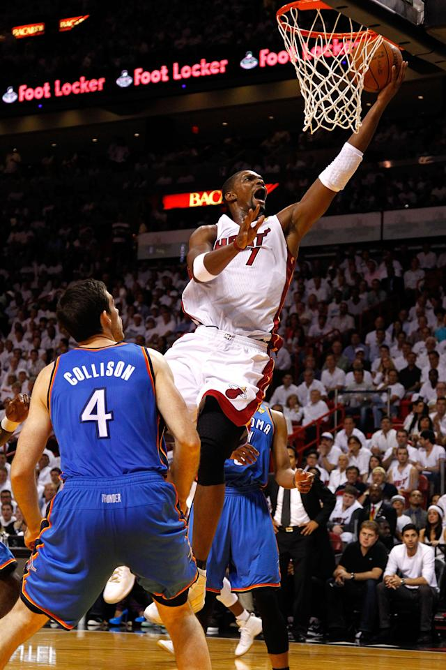 MIAMI, FL - JUNE 19: Chris Bosh #1 of the Miami Heat drives for a shot attempt in the first quarter against Nick Collison #4 of the Oklahoma City Thunder in Game Four of the 2012 NBA Finals on June 19, 2012 at American Airlines Arena in Miami, Florida. NOTE TO USER: User expressly acknowledges and agrees that, by downloading and or using this photograph, User is consenting to the terms and conditions of the Getty Images License Agreement. (Photo by Mike Ehrmann/Getty Images)