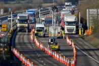 FILE PHOTO: Freight lorries are stopped to undergo checks on the M20 motorway