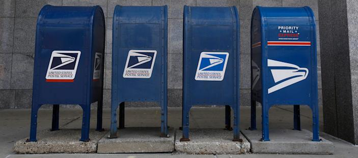 USPS mailboxes in-front of the George W. Young Post Office on Aug. 18, 2020.
