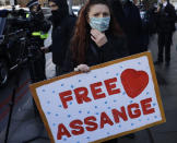 """A Julian Assange supporter reacts outside the Westminster Magistrates Court after Julian Assange was denied bail at a hearing in the court in London, Wednesday, Jan. 6, 2021. On Monday Judge Vanessa Baraitser ruled that Julian Assange cannot be extradited to the US. because of concerns about his mental health. Assange had been charged under the US's 1917 Espionage Act for """"unlawfully obtaining and disclosing classified documents related to the national defence"""". Assange remains in custody. (AP Photo/Matt Dunham)"""