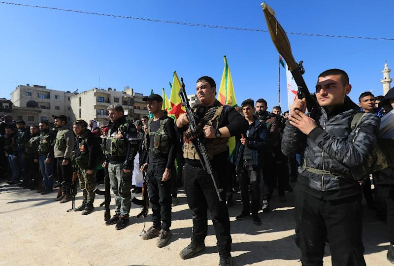 Syrian Kurds attend a parade in Afrin on January 28, 2018 as civilians enlist to fight an assault by Turkish troops and allied rebels on the enclave (AFP Photo/DELIL SOULEIMAN)
