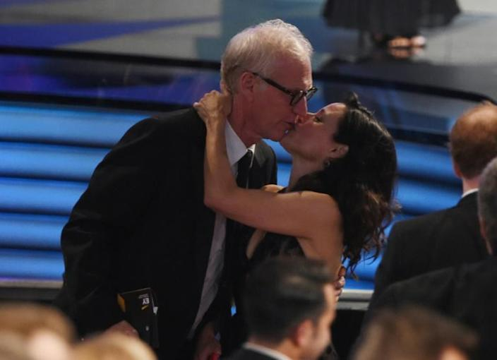Actress Julia Louis-Dreyfus (L) kisses her husband Brad Hall at the 2016 Emmy Awards -- they have been married for more than 30 years (AFP Photo/Valerie MACON)