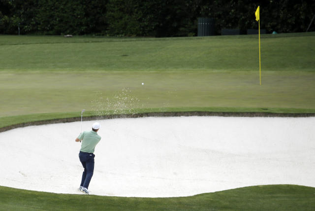 Jordan Spieth chips in for a birdie from a bunker on the fourth hole during the fourth round of the Masters golf tournament Sunday, April 13, 2014, in Augusta, Ga. (AP Photo/Charlie Riedel)