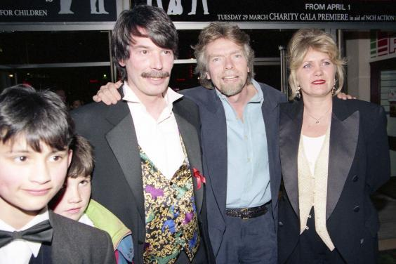 Powell with his children and Richard and Joan Branson at the UK premiere of 'Backbeat' in London, 1994 (Rex)