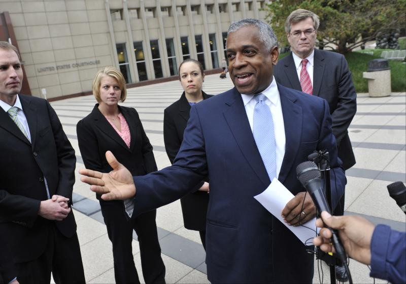 U.S. Attorney B. Todd Jones talks with reporters after a federal jury in Minneapolis on Thursday, Oct. 18, 2012 convicted Mahamud Said Omar on all five terrorism-related charges of helping send young men through a terrorist pipeline from Minnesota to Somalia. Also shown, from left background, prosecutor Charles Kovats, FBI agent Kian VanDenover, prosecutors LeeAnn Bell and John Docherty. (AP Photo/Jim Mone)