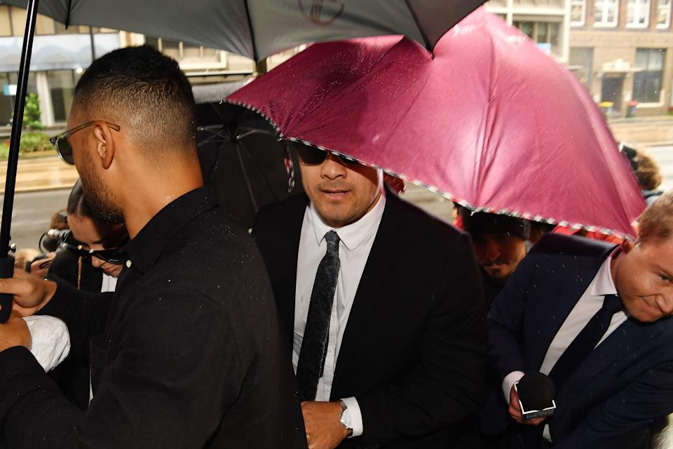 Jarryd Hayne arrives, surrounded by supporters, at Newcastle District Court on May 06, 2021.
