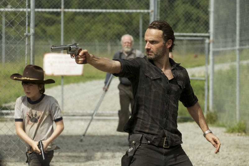 """Carl Grimes (Chandler Riggs) and Rick Grimes (Andrew Lincoln) - (Background) Hershel Greene (Scott Wilson) in """"The Walking Dead"""" episode, """"When the Dead Come Knocking."""""""