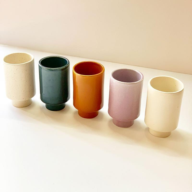 <p>We love these <span>Jungalow Kaya Solid Ceramic Cups by Justina Blakeney</span> ($20 each) because they're so versatile. They can be used for flowers, makeup brushes, you name it.</p>