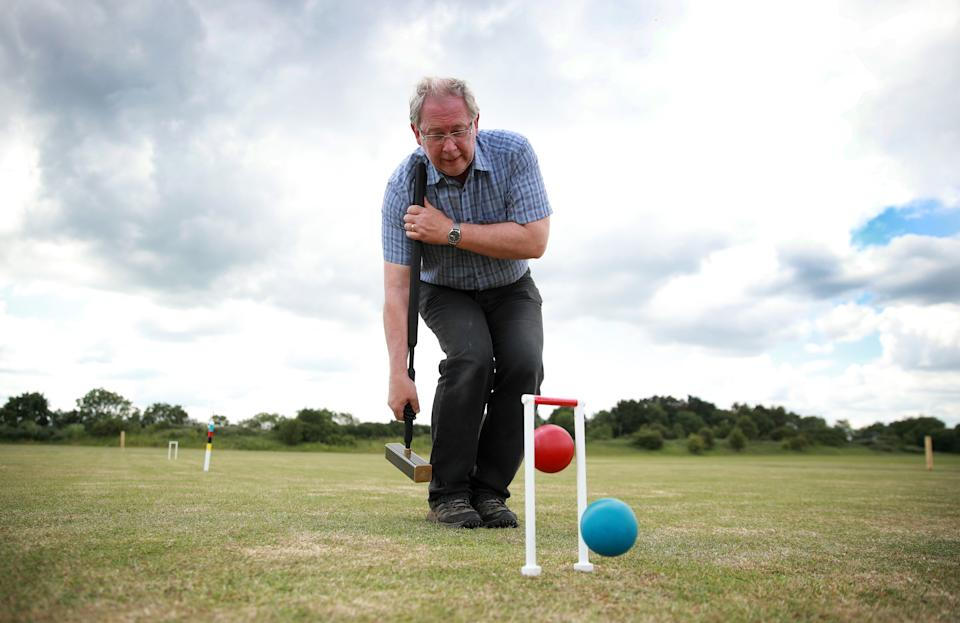 Paul Chard, a member of Northampton Croquet Club plays a jump shot at Old Grammarians sports grounds