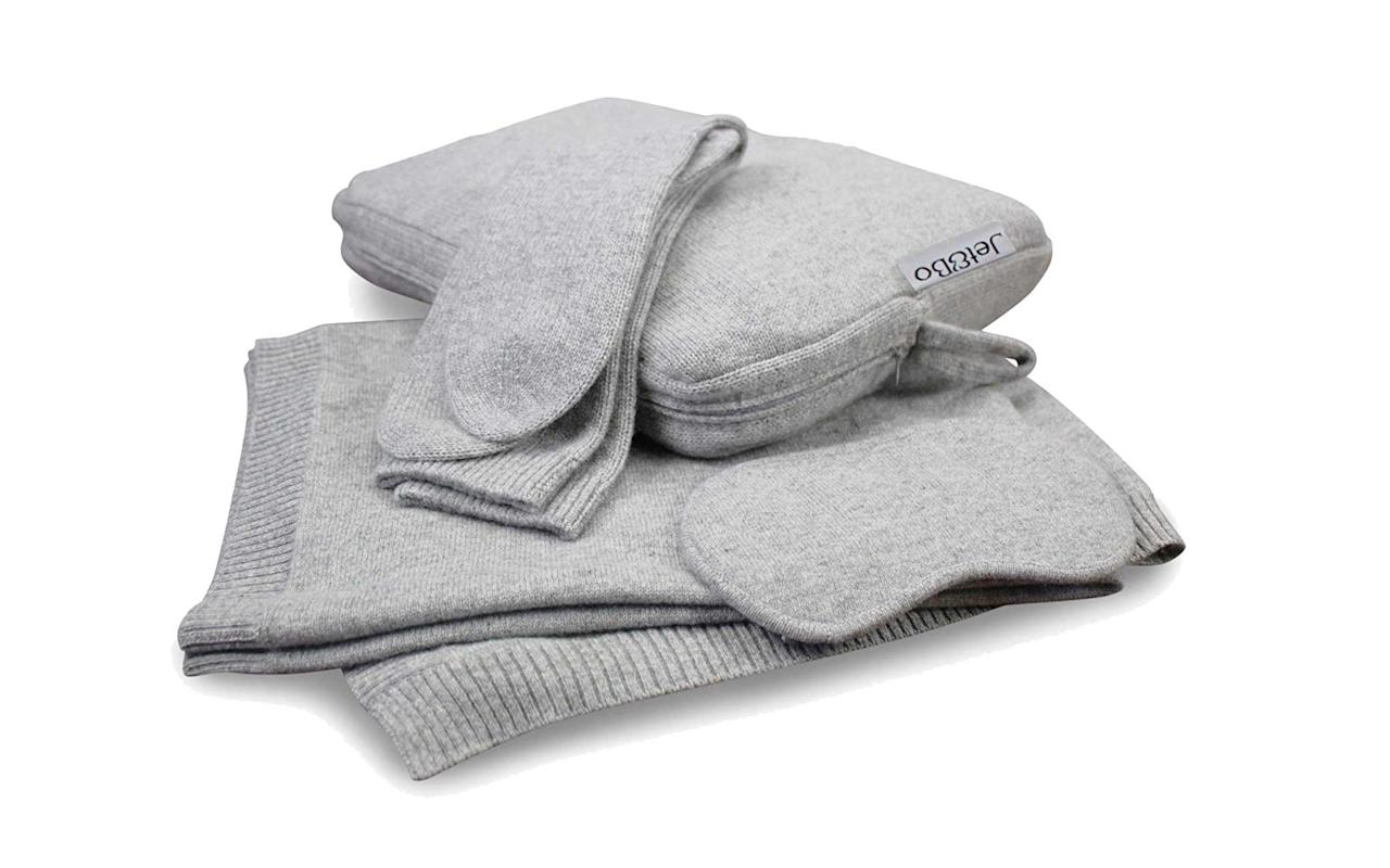 """<p>This unbelievably soft blanket, eye mask, and sock sleep set comes in its own easily storable travel case. Cuddling up with a blanket truly is the epitome of de-stressing and, if you ask us, totally necessary while traveling as well.</p> <p>To buy: <a href=""""https://www.amazon.com/Jet-Bo-100-Cashmere-Travel/dp/B01M1AMY4M?ie=UTF8&camp=1789&creative=9325&linkCode=as2&creativeASIN=B01M1AMY4M&tag=travandleis07-20&ascsubtag=d41d8cd98f00b204e9800998ecf8427e"""" target=""""_blank"""">amazon.com</a>, $360</p>"""