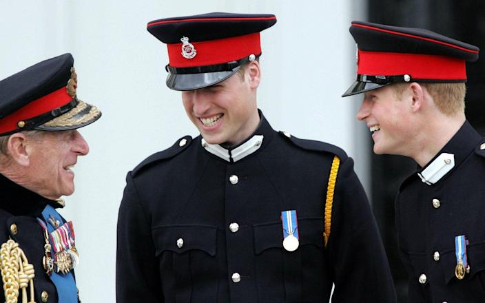 The Duke of Edinburgh with Prince William and Prince Harry at Sandhurst in 2006 - PA