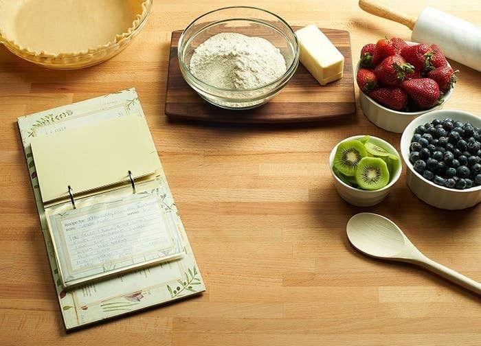 """You'll have a place to store all of your family's favorite recipes... or those concoctions you've recently stumbled upon on TikTok. This ring binder comes with 25 4""""x6"""" recipe cards, 50 clear plastic sleeves, and nine tab dividers with categories.<br /><br /><strong>Promising review:</strong>""""I don't have too many recipes (since I'm not the best cook lol), so I was looking for a really cute recipe book just to keep my favorites! They supple a handful of stylish note cards that match the binder to input your recipes, which I really liked. Also, it is a really cute decoration to display in your kitchen, too!"""" —<a href=""""https://www.amazon.com/dp/B000KG05X6?tag=huffpost-bfsyndication-20&ascsubtag=5833640%2C2%2C43%2Cd%2C0%2C0%2C0%2C962%3A1%3B901%3A2%3B900%3A2%3B974%3A3%3B975%3A2%3B982%3A2%2C16261693%2C0"""" target=""""_blank"""" rel=""""noopener noreferrer"""">AB<br /></a><br /><strong>Get it from Amazon for<a href=""""https://www.amazon.com/dp/B000KG05X6?tag=huffpost-bfsyndication-20&ascsubtag=5833640%2C2%2C43%2Cd%2C0%2C0%2C0%2C962%3A1%3B901%3A2%3B900%3A2%3B974%3A3%3B975%3A2%3B982%3A2%2C16261693%2C0"""" target=""""_blank"""" rel=""""noopener noreferrer"""">$14.99+</a>(available in three designs).</strong>"""