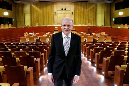 European Court of Justice president Lenaerts poses inside the main courtroom in Luxembourg