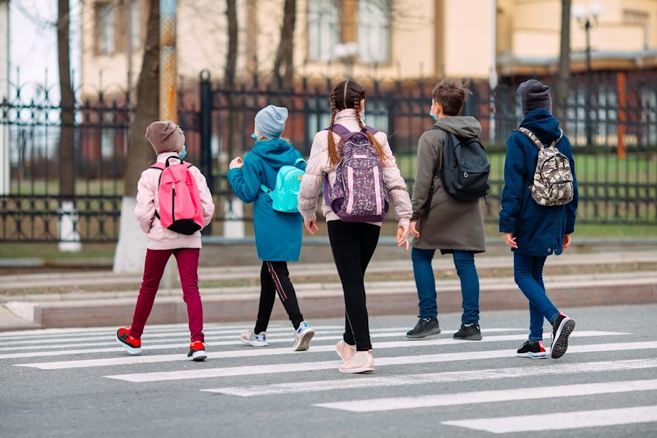School children crossing the road. Source: Getty Images