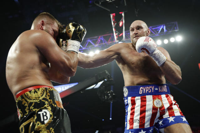Tyson Fury, of England, hits Tom Schwarz, of Germany, during a heavyweight boxing match Saturday, June 15, 2019, in Las Vegas. (AP Photo/John Locher)