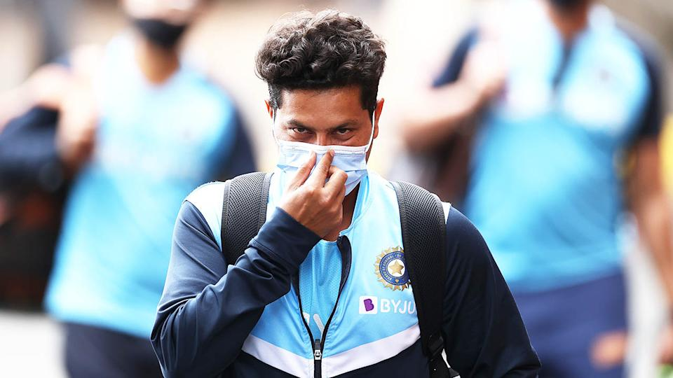 Kuldeep Yadav of India arrives in a face mask during the India nets session at the SCG.