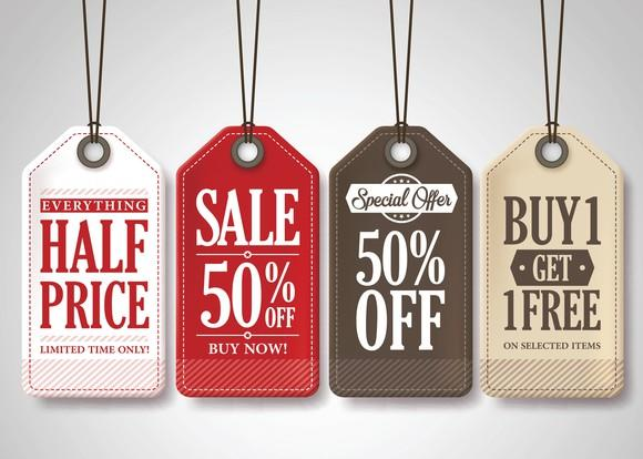 Multicolored sales tags displaying special deals.