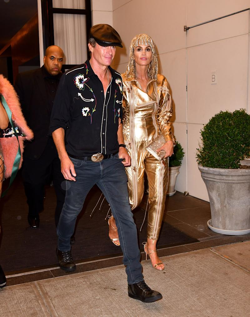 While Kaia Gerber was dressed up as her mom, Cindy Crawford wore a metallic gold outfit for her daughter's birthday party.